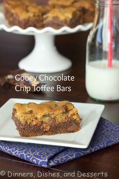 Gooey Chocolate Toffee Bars - chocolate chip cookie base, topped with a layer of chocolate ganache, then crushed toffee candy, then more chocolate chip cookie.  Yum!