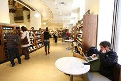 Shoppers can enjoy wine by the glass at seating areas in between the huge selection of wine on the second floor during the grand opening of the new Heinen's grocery store in downtown Cleveland on Wednesday, Feb. 25, 2015. (Lisa DeJong / The Plain Dealer)
