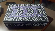 Craft box I made my little! Box is from Hobby Lobby.  Then added stick on pearls to the boarder on the lid.  Finish off with purple sigmas and add some bling (Hobby Lobby sells a big bucket of them)!!! Tri Sigma love!!! :)