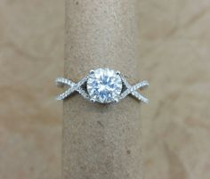 Dainty criss cross micro pave engagement by MichaelPatrickHogan
