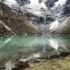 This crystal clear lake at the base of Mt. Salkantay in Peru really took my�