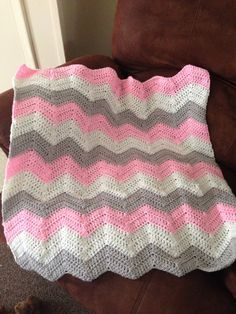 Crocheted cheveron baby girl blanket.
