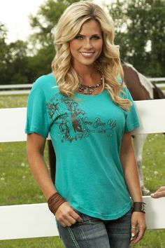 From Cowgirl Tuff Company  Curvy excellence! This flowy top has some major feminine touches with simple scoop neck, full curve bottom and sweet dolman style sleeves. Dark brown Cowgirl Tuff Co. print and Swarovski crystals lay nicely on the low shoulder. Bright teal bamboo/cotton/soybean. Juniors fit. Extended sizes available.