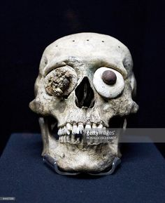 A skull mask is seen inside the 'Templo Mayor' Museum in Mexico City on January 23, 2009. The 'Templo Mayor' museum is located next to the archaeological zone of Tenochtitlan, which founded in 1325 was the capital city of the Aztec civilization. AFP PHOTO/Ronaldo SCHEMIDT