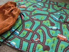 """I am SO going to use this fabric on the inside of the """"Lego drawstring bag,"""" but make it into a bag and play mat for cars!  Aliza will love it.  Great gift idea too."""