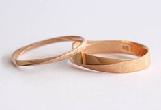 his and hers set Exclusive to Benati. A new meaningful, contemporary mobius wedding rings set. Mobius wedding rings crafted in 14k solid gold in approx. 4.5 mm and 2 mm width - a beautiful meaningful symbol on your finger, a perfect wedding set! These rings are made to perfection and