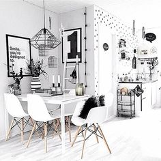 I am just loving tripod chairs are the dining table. White and Black decor