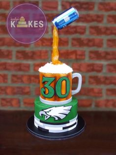 Bottom tier is iced in buttercream. Beer mug on top is covered with marshmallow fondant (MMF). Beer foam is buttercream. Pouring beer is sugar. MMF Eagles logo and decorations. Beer Birthday Cake For Men, 30th Birthday Cupcakes, Zebra Birthday, Thomas Birthday, 40th Birthday, Birthday Ideas, Football Treats, Cupcakes For Men, Birthday Dinners