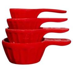 "Bring a pop of color to your kitchen with these charming measuring cups, crafted from ceramic and showcasing red finishes.  Product: 1/3 Cup measuring cup1/4 Cup measuring cup1/2 Cup measuring cup1 Cup measuring cupConstruction Material: CeramicColor: RedFeatures:Ribbed exteriorDimensions: 1/3 Cup: 1.61"" H x 5.28"" W x 2.52"" D1/4 Cup: 1.26"" H x 5.35"" W x 3.11"" D1/2 Cup: 1.38"" H x 5.55"" W x 3.54"" D1 Cup: 1.93"" H x 4.84"" W x 3.94"" D"
