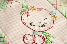 I've  mainly  hand embroidered on white dish towels - this looks really fun on the gingham
