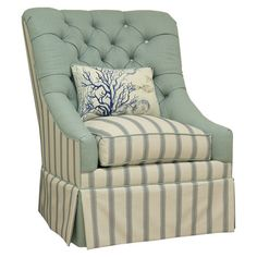 Handmade tufted cotton arm chair with a complementing accent pillow and hardwood frame.   Product: ChairConstruction ...
