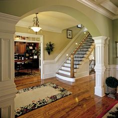 Love the deco mouldings and archway...maybe betwen foyer and dining room?