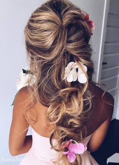 We've collected 11 of our favorite effortlessly romantic wedding hairstyles that will make your groom fall in love with you all over again!