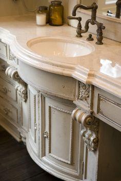 Elegant light grey bathroom sink base. Photo: Habersham Home.