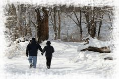 A couple walking in the snow at the Falls of the Ohio State Park