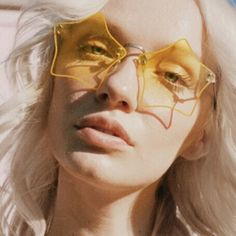 *** yellow tinted sunglasses ***
