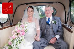 Bride in Vintage wedding car with her father arriving at the church  - Bride has waterfall bouquet www.grahamcrichton.com