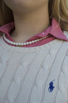 A classic cable knit sweater and pearls is the perfect, preppy fall look!
