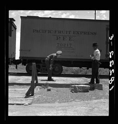Inspecting a freight train from Mexico for smuggled immigrants, June Photo credit: Dorothea Lange / Library of Congress — in El Paso, Texas.