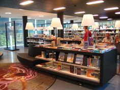 displays with lamps- back partitions with images- almere public library by Erozz, via Flickr