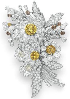 A colored diamond and diamond brooch, Bulgari, circa 1959. Elizabeth Taylor…