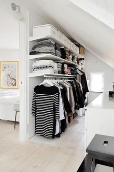 Interesting idea for closet space in an a-frame house. I like how it divides the space as well. Could use ikea cubbies to create interesting wall/bookshelf space.