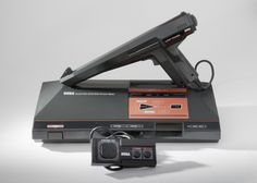 Sega Master System with controller and light gun.