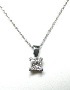 "Princess Cut Diamond Pendant - A 0.50ct princess cut diamond set in 14kt white gold. The diamond is ""H"" in color and ""SI-1"" in clarity. K309096. (subject to prior sale) -- Lilliane's Jewelry -- 4101 W. 83rd St. Prairie Village, KS 66208 -- 913-383-3376 –"