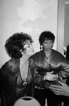 legendary duck face. Elizabeth Taylor and Lena Horne mugging for the camera. .. back then I'm sure it was called a 'pout'