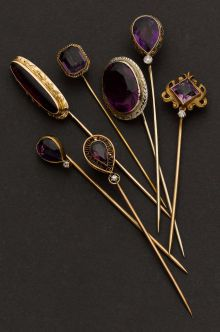 Estate Jewelry:Stick Pins and Hat Pins, Seven Amethyst & Gold Stick Pins.