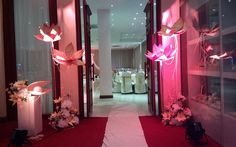 Entrance decorations using paper flowers.