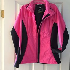 Avalanche Running Jacket Never worn! Pink nylon and blank spandex running jacket in size medium. Perforated panel in back. Zippered pockets in front and thumb holes in sleeves. Jackets & Coats