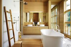 Master bath paneled in wood. Inspired by tree lined setting. Floor to ceiling windows.