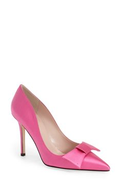 A prim Kate Spade bow effortlessly refines this shapely satin pink pump.