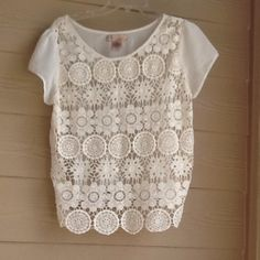 Crotchet front top See through crotchet front. Sheer material on the back. Short sleeves. Off white color. Self is 100% cotton. Contrast is 100% polyester. Francesca's Collections Tops Blouses