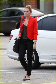 black shirt, black jeans, and red blazer