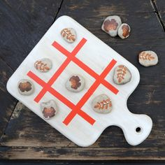 Outdoor tic tac toe made out of a cutting board and rocks- C.R.A.F.T.