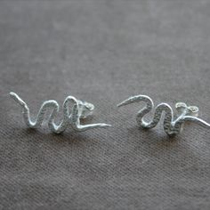Small snake earrings studs with texture Snake Earrings, Silver Earrings, Stud Earrings, Small Snakes, Jewelry Collection, Heart Ring, Studs, Texture, Surface Finish
