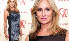 Sonja Morgan is ageless beauty in silver minidress with sheer cutouts