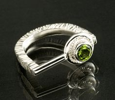 Beautiful sterling silver and peridot ring (my birthstone) made by my friend, Jen Lawler