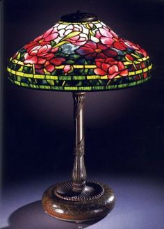 """Tiffany Studios, New York, Favrile Leaded Glass and Patinated Bronze """"Peony"""" Lamp."""