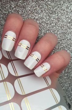 Manicure Ideas Metallic Nails | The angelic quality of this wrap with metallic gold lines over white is a perfect way to show your sweet innocence.