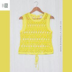 Con el amarillo irradias buena energía y las texturas que dejan ver tu piel te hacen ver muy sexy.