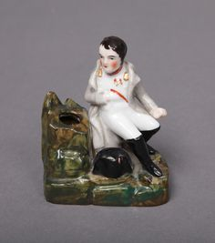 French Porcelain Miniature Napoleon-Figural Inkwell. Attributed to Jacob Petit mold of Napoleon Bonaparte seated by the tree trunk form inkwell, 19th century #antiques #decorativearts   www.linkauctiongalleries.com Napoleon, Snow Globes, 19th Century, Art Decor, Auction, Porcelain, Miniatures, French, Detail