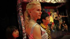 A teenager looks at a wax statue of Australian actress Nicole Kidman at the Madame Tussauds Wax Museum in Shanghai.