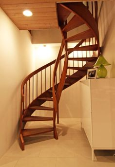 Replace existing stairs with a wooden spiral staircase!
