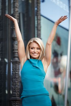 Television host Kelly Ripa poses with her star on the Hollywood Walk of Fame, Oct. 12, 2015, in Hollywood, Calif.