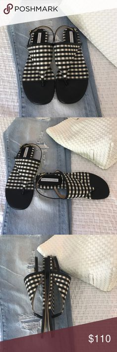 DVF Gingham sandals new Just in - fabulous gingham black and white leather and canvas sandals from Diane Von Furstenberg. Size 8.5, fits true to size. These are so delightful because they conjure up a 1950's picnic or beach theme or maybe Gidget. Kids will have to google Gidget but she is timeless. I do not have the DVF box but they will come in a Tory Burch or Vince box or Kate Spade. Buyer's choice. DVF Shoes Sandals