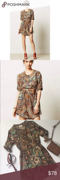 """NWOT Anthropologie Paisley Print Shirt Dress Gorgeous design by Holding Horses sold by Anthropologie. Paisley print shirt dress with hues of browns, aqua and gold. Bohemian print equipped with rolled button sleeves and two pocket front detail. Buttons at chest and cinched waist. Pair with a belt and your favorite wedge heels. This is NWOT. Never worn and in the most excellent condition. Chest measures 17"""" and length is 33"""" Material is 💯 rayon. Home is smoke and pet free 🌺✌️ Anthropologie…"""