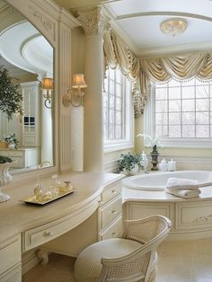 Bathroom by designer Peter Salerno. The entire space features a creamy white palette, allowing the elaborate trim work and architectural details to be the true focus of the design. ~ Simple Color Scheme - Master Bathroom With Romantic Style on HGTV